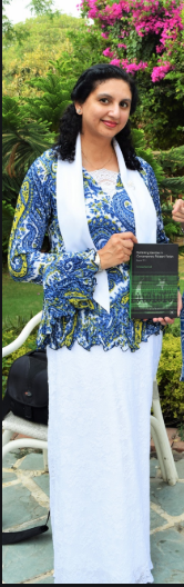 dr. aroosa kanwal with her book